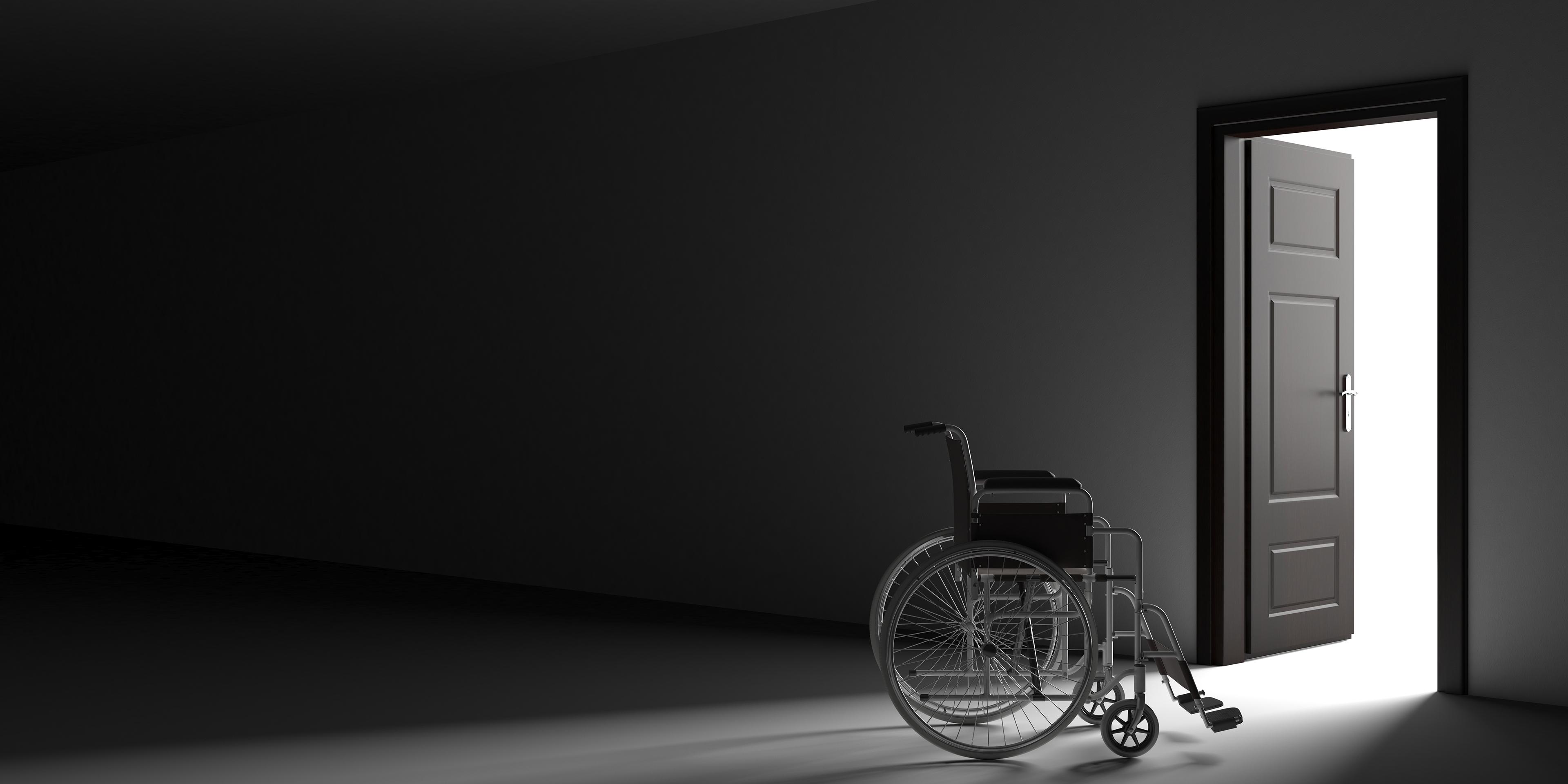 empty wheelchair in dark hallway