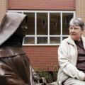 Sister Bridget looking at statue