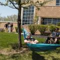 Student lounging in a hammock