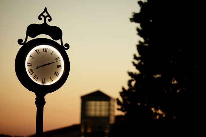 clock at sunset