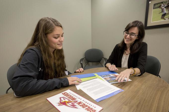 Admissions counselor talks with student