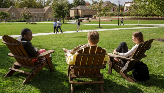 Students in Adirondack chairs