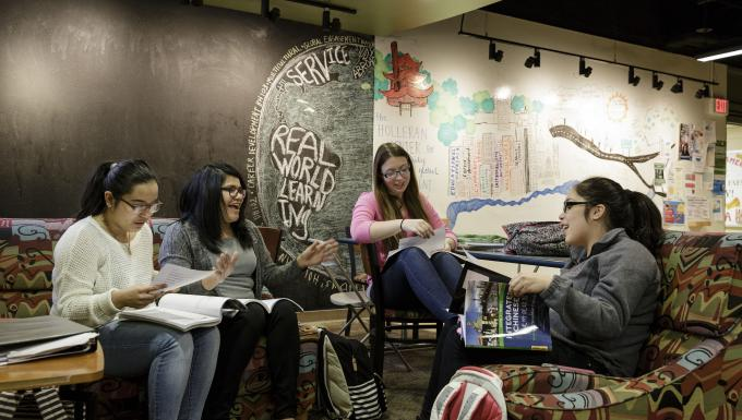 Female students study in Bernardine Hall Lounge