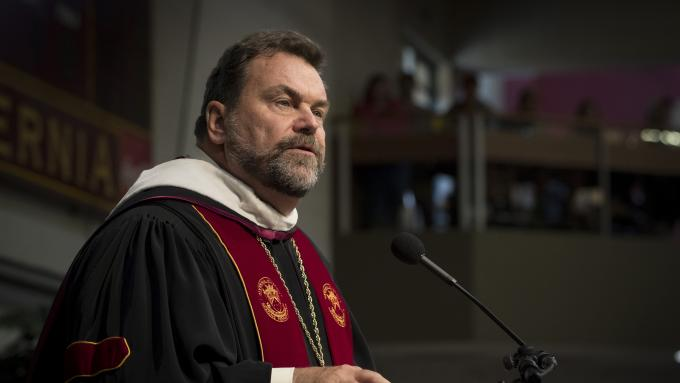 President Flynn speaking at convocation