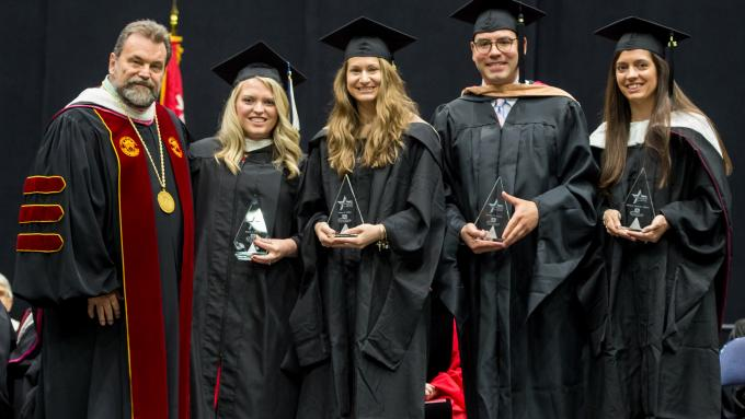 Dr. Flynn presents the 2019 Cohort of Four Under Forty Alumni Awards