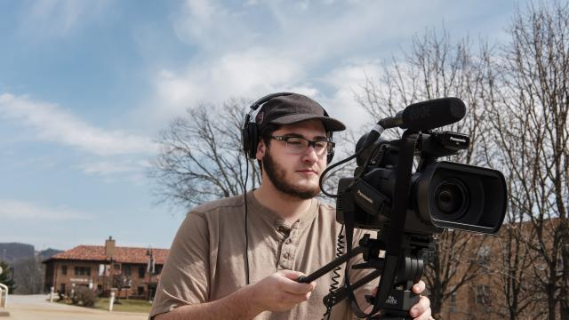A student shoots video on campus.