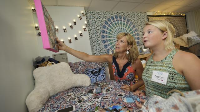 Mom and daughter setting up dorm room