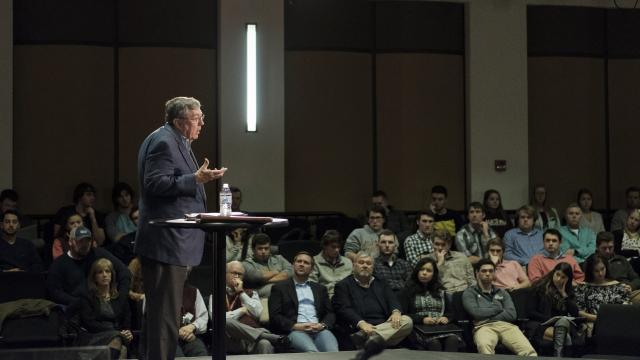 Speaker lecturing in Francis Hall Theater