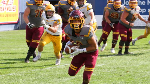 Alvernia Football Player with ball