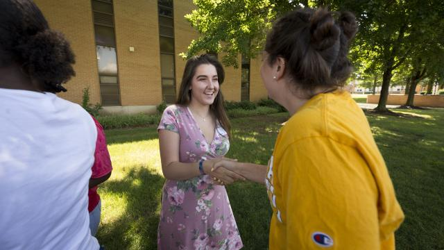 Female students shaking hands